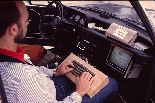 Softrek - Jim Salmons using Apple computer in car 1982